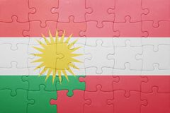 Puzzle with the national flag of kurdistan and austria. Concept Stock Image