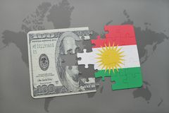 Puzzle with the national flag of kurdistan and dollar banknote on a world map background. 3D illustration Royalty Free Stock Photo