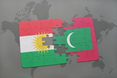 Puzzle with the national flag of kurdistan and maldives on a world map background. Stock Photos