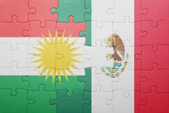 Puzzle with the national flag of kurdistan and mexico. Concept stock photography