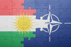 Puzzle with the national flag of kurdistan and nato Stock Photos