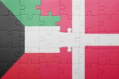 Puzzle with the national flag of kuwait and denmark. Concept Royalty Free Stock Images