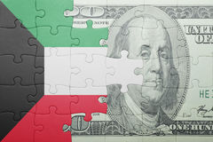 Puzzle with the national flag of kuwait and dollar banknote Royalty Free Stock Photo