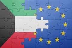 Puzzle with the national flag of kuwait and european union Stock Images