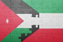 Puzzle with the national flag of kuwait and jordan. Concept Stock Photo