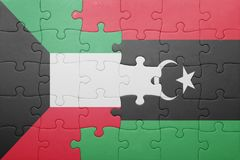 Puzzle with the national flag of kuwait and libya. Concept Stock Photography