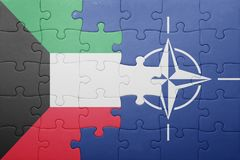 Puzzle with the national flag of kuwait and nato Royalty Free Stock Photography