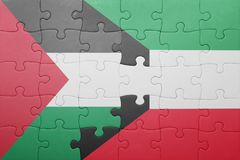 Puzzle with the national flag of kuwait and palestine. Concept Royalty Free Stock Images