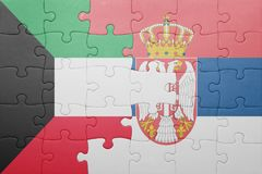 Puzzle with the national flag of kuwait and serbia . concept. Puzzle with national flag of kuwait and serbia . concept Stock Images