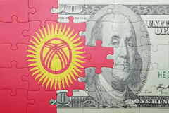 Puzzle with the national flag of kyrgyzstan and dollar banknote Stock Image