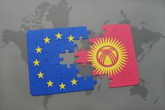 Puzzle with the national flag of kyrgyzstan and european union on a world map Royalty Free Stock Photos