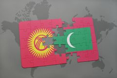 Puzzle with the national flag of kyrgyzstan and maldives on a world map background. 3D illustration Stock Photo
