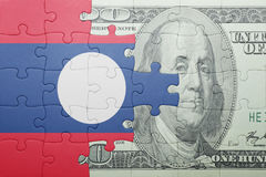 Puzzle with the national flag of laos and dollar banknote Royalty Free Stock Photography