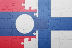 Puzzle with the national flag of laos and finland. Concept Royalty Free Stock Image