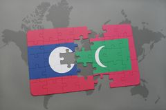 Puzzle with the national flag of laos and maldives on a world map background. 3D illustration Stock Images