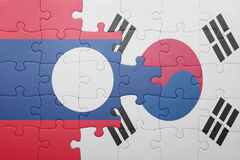 Puzzle with the national flag of laos and south korea. Concept stock images