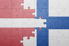 Puzzle with the national flag of latvia and finland. Concept Stock Photography