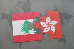 Puzzle with the national flag of lebanon and hong kong on a world map background. 3D illustration Stock Photo