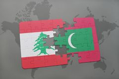 Puzzle with the national flag of lebanon and maldives on a world map background. Royalty Free Stock Photography