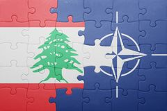 Puzzle with the national flag of lebanon and nato Royalty Free Stock Image