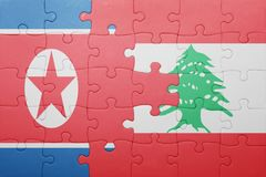 Puzzle with the national flag of lebanon and north korea Royalty Free Stock Photography