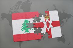 Puzzle with the national flag of lebanon and northern ireland on a world map background. 3D illustration Royalty Free Stock Photo