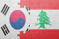 Puzzle with the national flag of lebanon and south korea. Concept royalty free stock photo