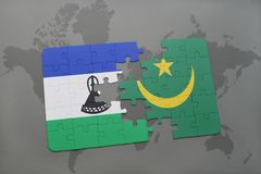 puzzle with the national flag of lesotho and mauritania on a world map Royalty Free Stock Photo