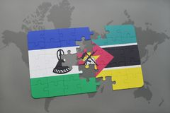 Puzzle with the national flag of lesotho and mozambique on a world map. Background. 3D illustration Royalty Free Stock Photos
