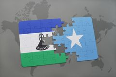 Puzzle with the national flag of lesotho and somalia on a world map. Background. 3D illustration stock photos