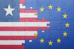 Puzzle with the national flag of liberia and european union Stock Image