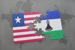 puzzle with the national flag of liberia and lesotho on a world map Royalty Free Stock Photos