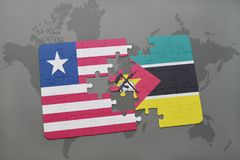 Puzzle with the national flag of liberia and mozambique on a world map. Background. 3D illustration Royalty Free Stock Images