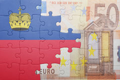 Puzzle with the national flag of liechtenstein and euro banknote Stock Photography