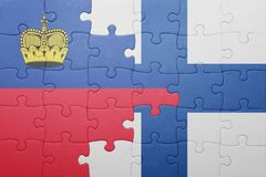 Puzzle with the national flag of liechtenstein and finland Stock Image