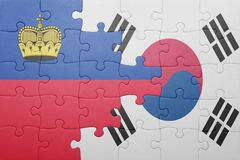 Puzzle with the national flag of liechtenstein and south korea. Concept stock images
