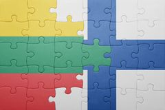 Puzzle with the national flag of lithuania and finland Royalty Free Stock Photography