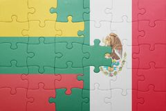 Puzzle with the national flag of lithuania and mexico. Concept stock image
