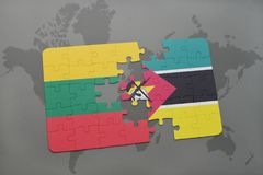 Puzzle with the national flag of lithuania and mozambique on a world map. Background. 3D illustration Royalty Free Stock Image