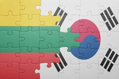 Puzzle with the national flag of lithuania and south korea. Concept royalty free stock photos
