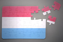 Puzzle with the national flag of luxembourg Stock Image