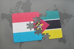 Puzzle with the national flag of luxembourg and mozambique on a world map. Background. 3D illustration Royalty Free Stock Photography