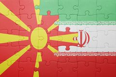 Puzzle with the national flag of macedonia and iran Stock Photography