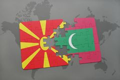 Puzzle with the national flag of macedonia and maldives on a world map. Background. 3D illustration Royalty Free Stock Images