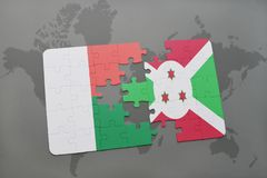 Puzzle with the national flag of madagascar and burundi on a world map. Background. 3D illustration Stock Photography