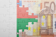 Puzzle with the national flag of madagascar and euro banknote. Concept Royalty Free Stock Photo