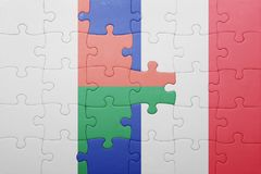 Puzzle with the national flag of madagascar and france. Concept Stock Photography