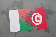 Puzzle with the national flag of madagascar and tunisia on a world map. Background. 3D illustration Stock Image