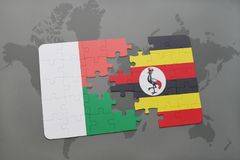 Puzzle with the national flag of madagascar and uganda on a world map. Background. 3D illustration Royalty Free Stock Photos