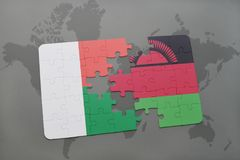 Puzzle with the national flag of madagascar and on a world map. Background. 3D illustration Stock Photos